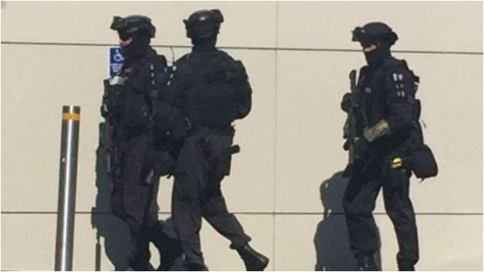 Armed police race through a Christchurch shopping mall